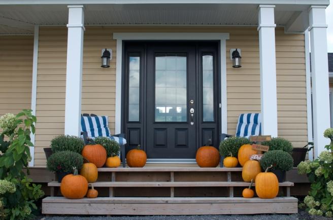 Front porch pumpkins and mums