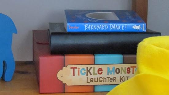 Nursery books stacked.